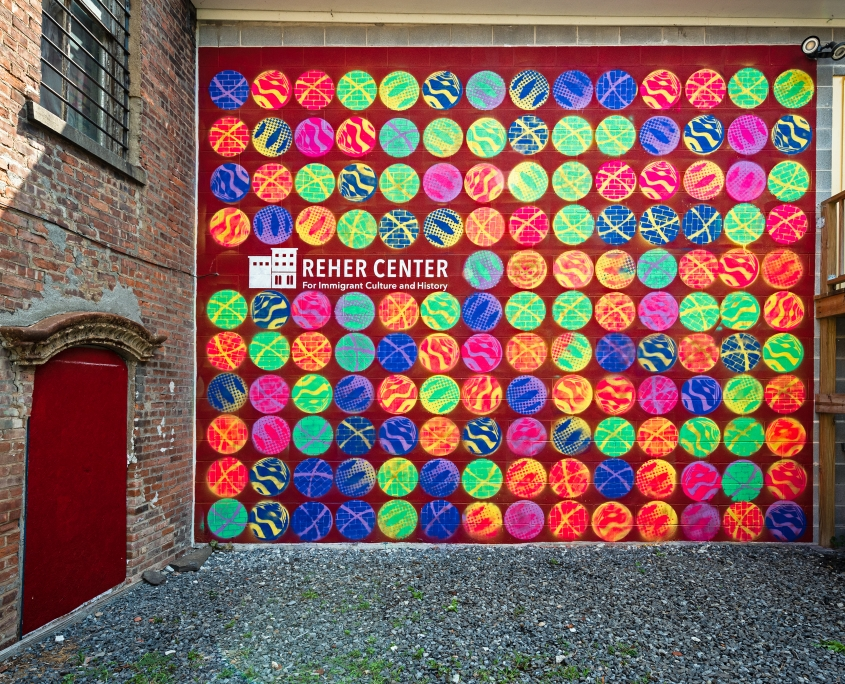 Reher Center Mural representing the iconic Reher Center rolls along with community interpretation.